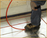 Installing a hydronic heated floor. Pex tubing being installed in Rau Panel.