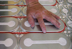 Placing heat cable in the grooves of a HeatShield floor heating insulation panel