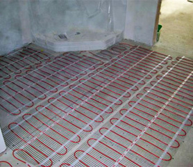 Heating Mats Being Installed To Heat A Bathroom Floor