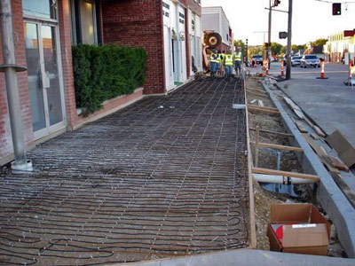 Heated sidewalks being installed