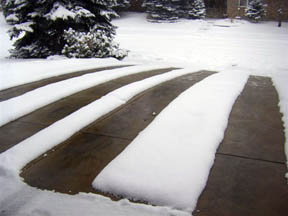 Heated tire tracks in residential concrete heated driveway