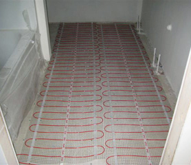 Radiant heated floor being installed in bathroom.