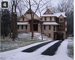 Heated asphalt driveway retrofitted with heated tire tracks.