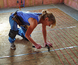 Installing radiant floor heating cable