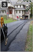 Asphalt driveway being retrofitted with heated tire tracks - 3