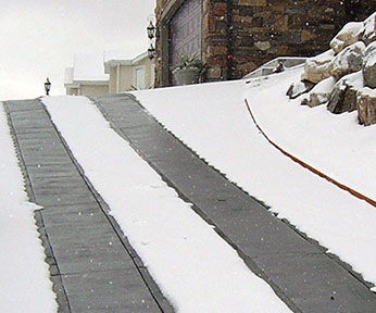 Heated driveway on incline with heated tire tracks