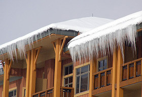 Roof with snow and ice build up, in need of a roof deicing system.