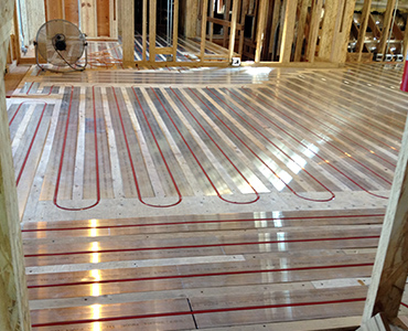 Hydronic floor heating system featuring RAU Panels