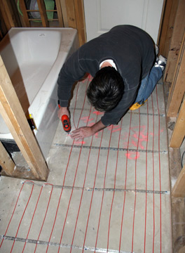Floor heating cable being installed