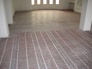 Floor heating mats being installed