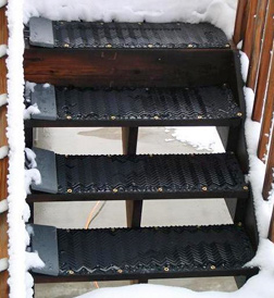 Heated traction mats for outdoor steps