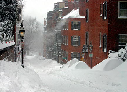 Snow accumulating on streets and roofs in Boston during blizzard