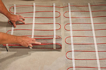 Installing floor heating cable mats