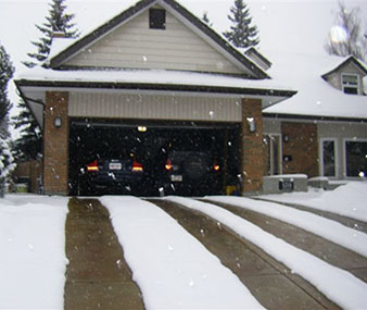 Power requirements and operating costs of a heated driveway warmzone heated driveway with four heated tire tracks solutioingenieria Choice Image