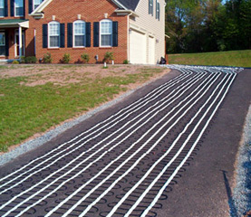 Snow melting heat cable laid out for asphalt heated driveway.