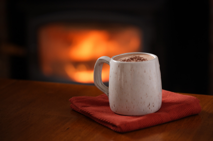 A warm mug of hot chocolate by the fire