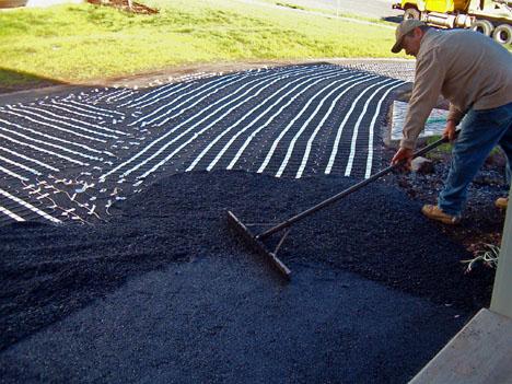 Installing a heated asphalt driveway