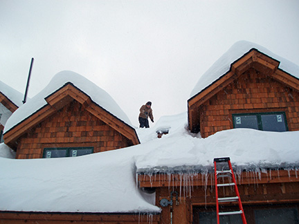 Clearing snow off of roof